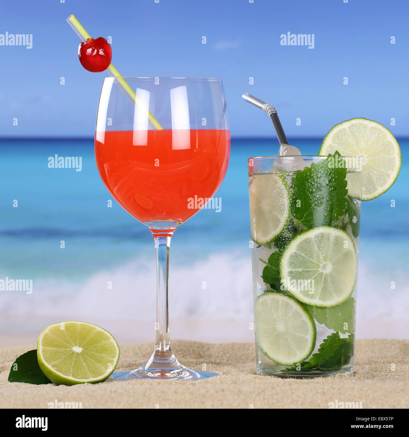 Cocktails and cold drinks on the beach with sand and sea - Stock Image