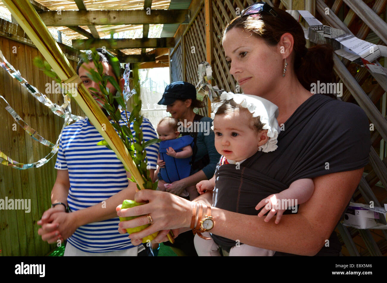 GOLD COAST - OCT 12 2014:Jewish people blessing on the four spices in a Sukkah on Sukkot Jewish Holiday.There are - Stock Image