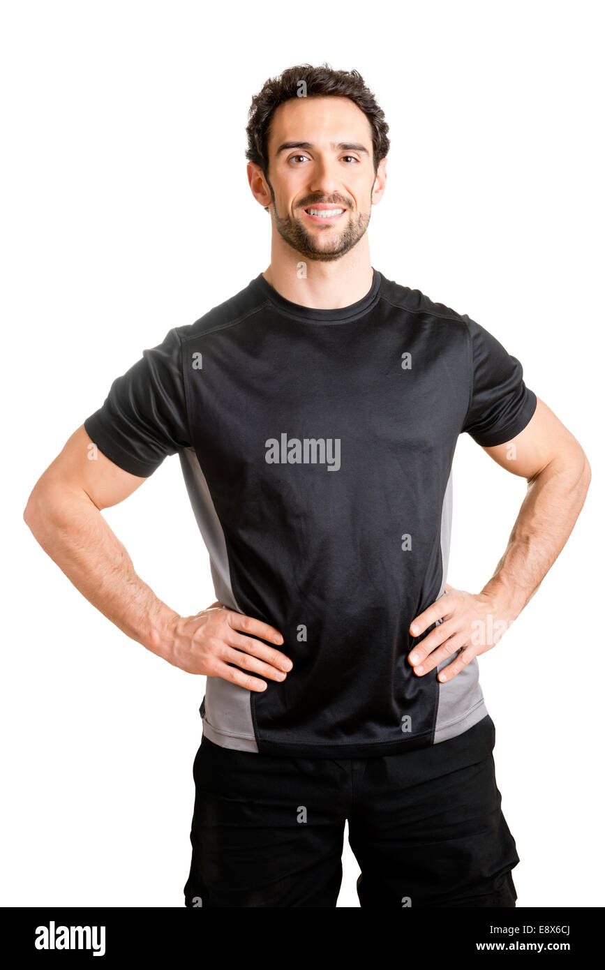Personal trainer with is arms on his waist, isolated in white - Stock Image