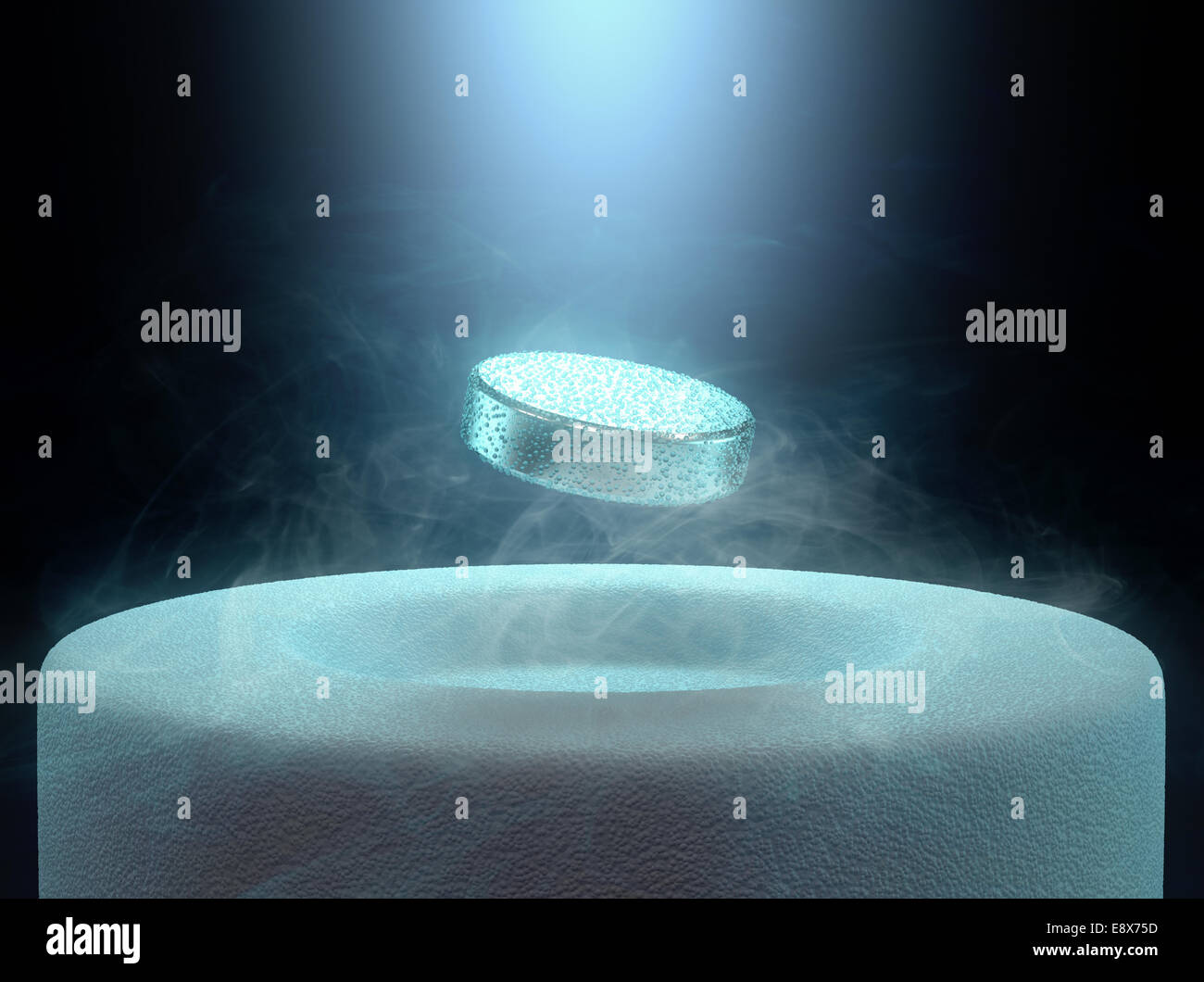 Image concept of magnetic levitating above a high-temperature superconductor, cooled with liquid nitrogen. - Stock Image