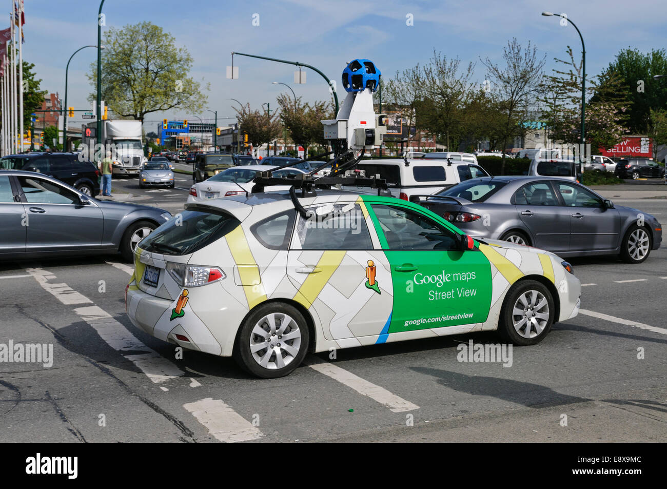 A Google Street View mapping vehicle in car traffic, Vancouver, B.C., Canada - Stock Image