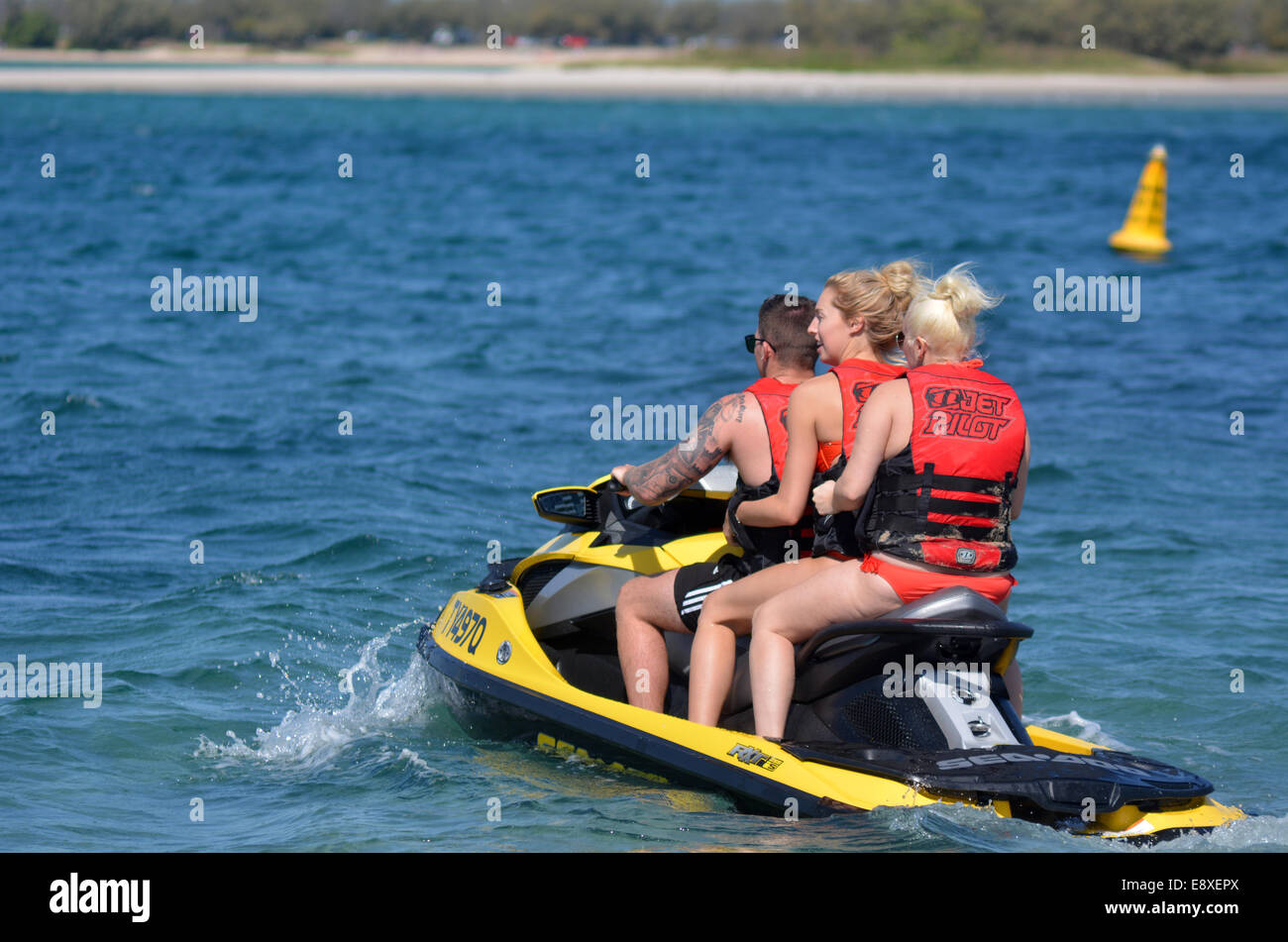 GOLD COAST - SEP 09 2014:Young Australian people on water scooter. Its a very popular water sport in the waterway - Stock Image