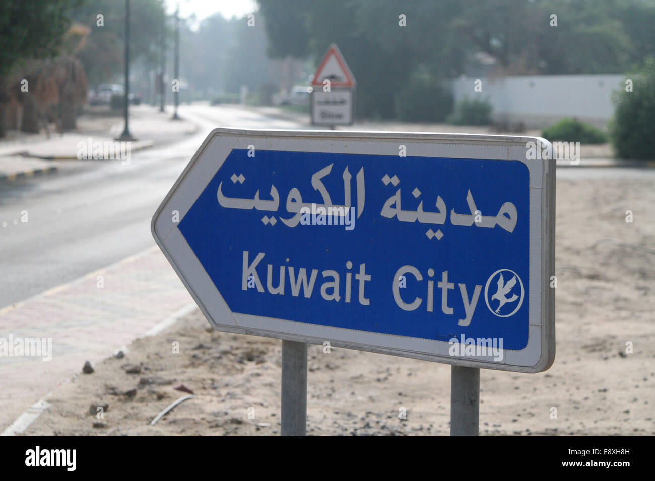 Road sign to Kuwait City, in Ahmadi, Kuwait - Stock Image