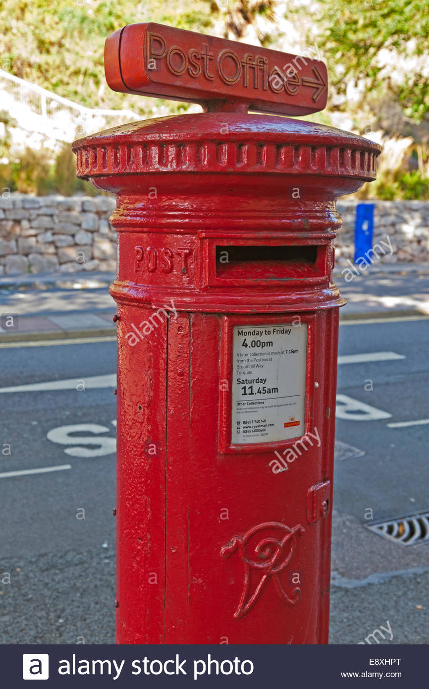 Victorian post box with Post Office direction sign on top Stock Photo