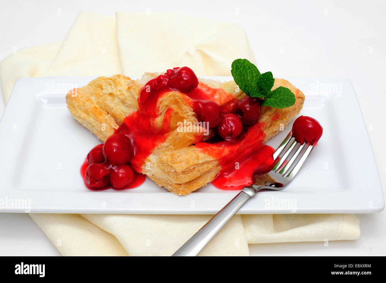 Turnover Topped With Cherries - Stock Image