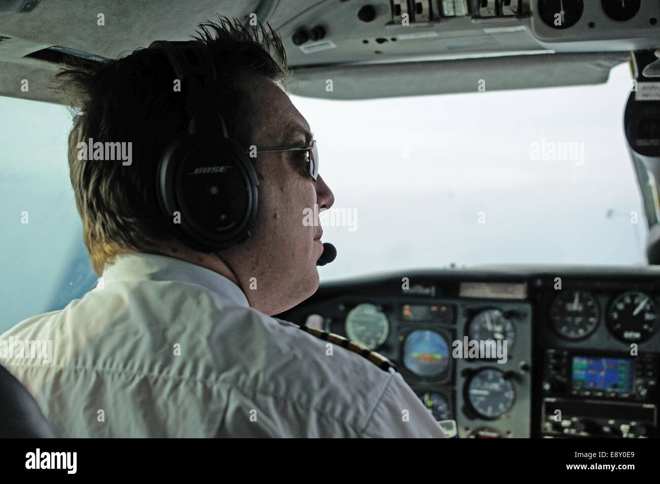 A pilot at the controls of a Piper Chieftain twin-engined aircraft - Stock Image