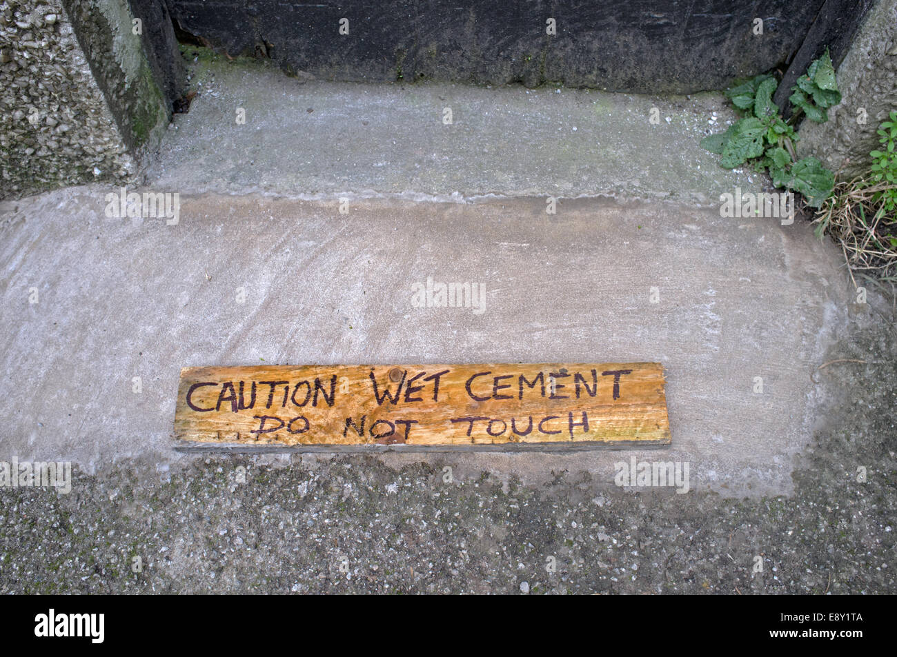 A wooden sign urging caution - Stock Image