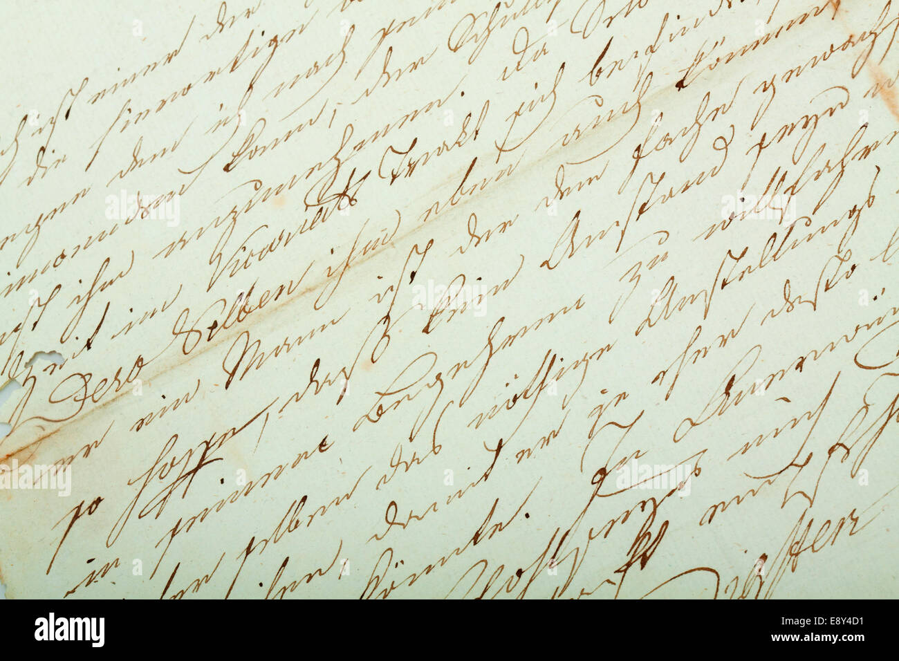 Hand writing on very old paper - Stock Image