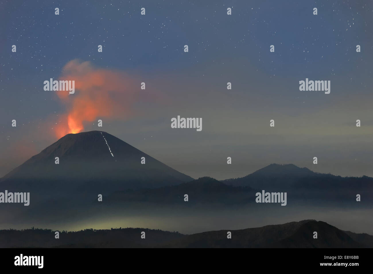 Active Gunung Bromo volcano at night, Bromo-Tengger-Semeru National Park, Java, Indonesia, Asia - Stock Image