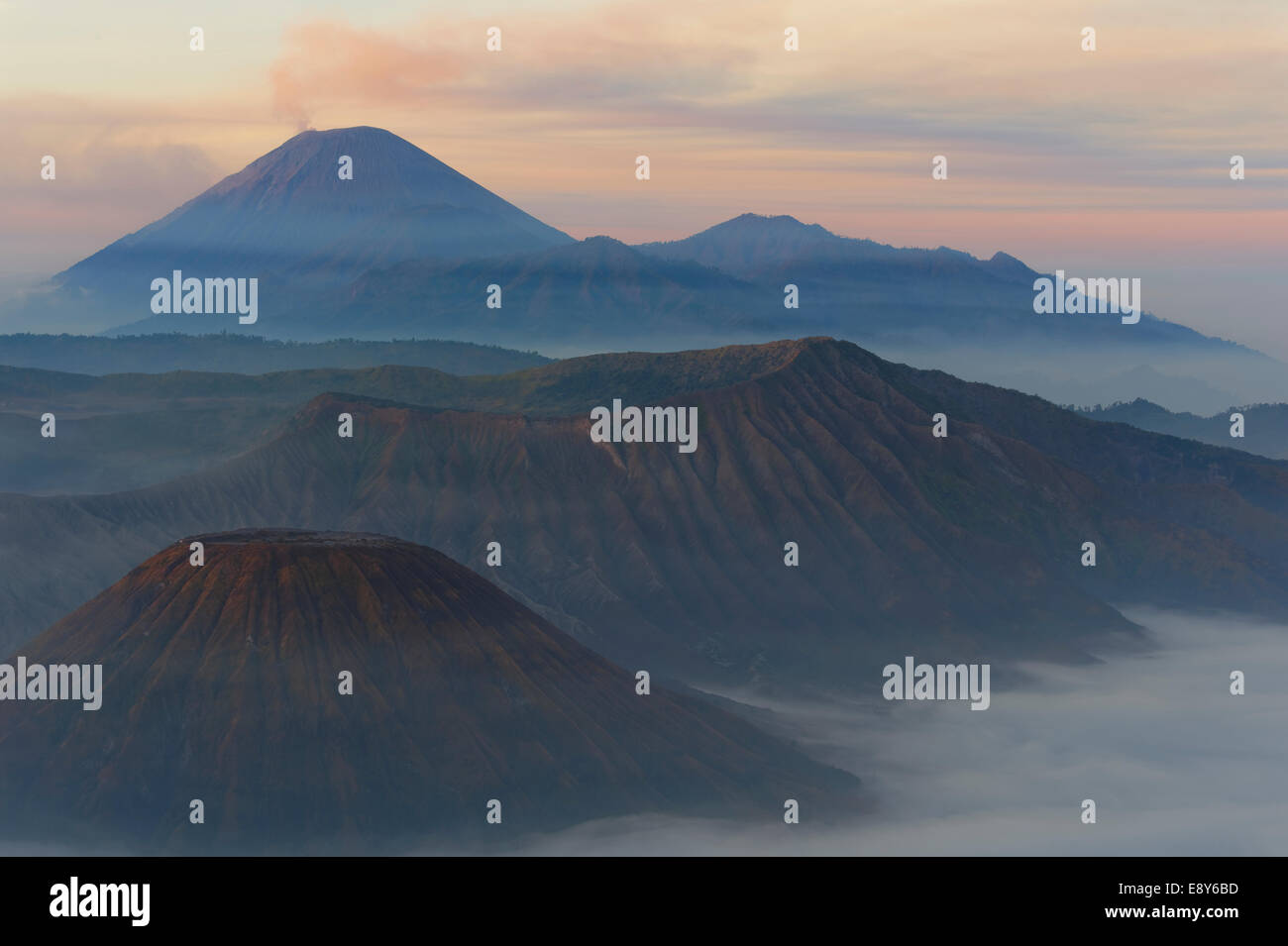 Sunrise over the smoking Gunung Bromo volcano, Bromo-Tengger-Semeru National Park, Java, Indonesia, Asia - Stock Image