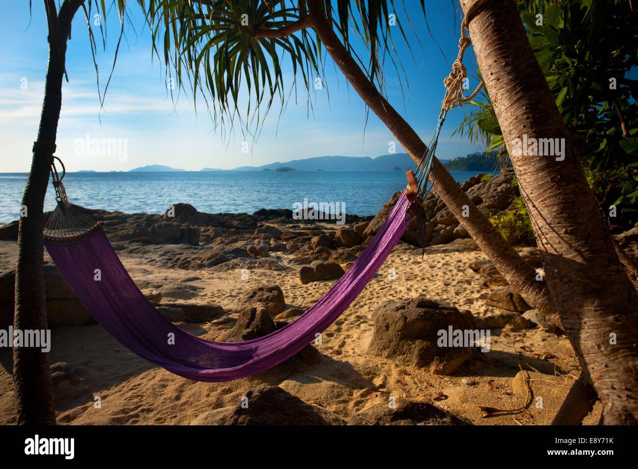 Hammock Secluded Jungle Beach - Stock Image