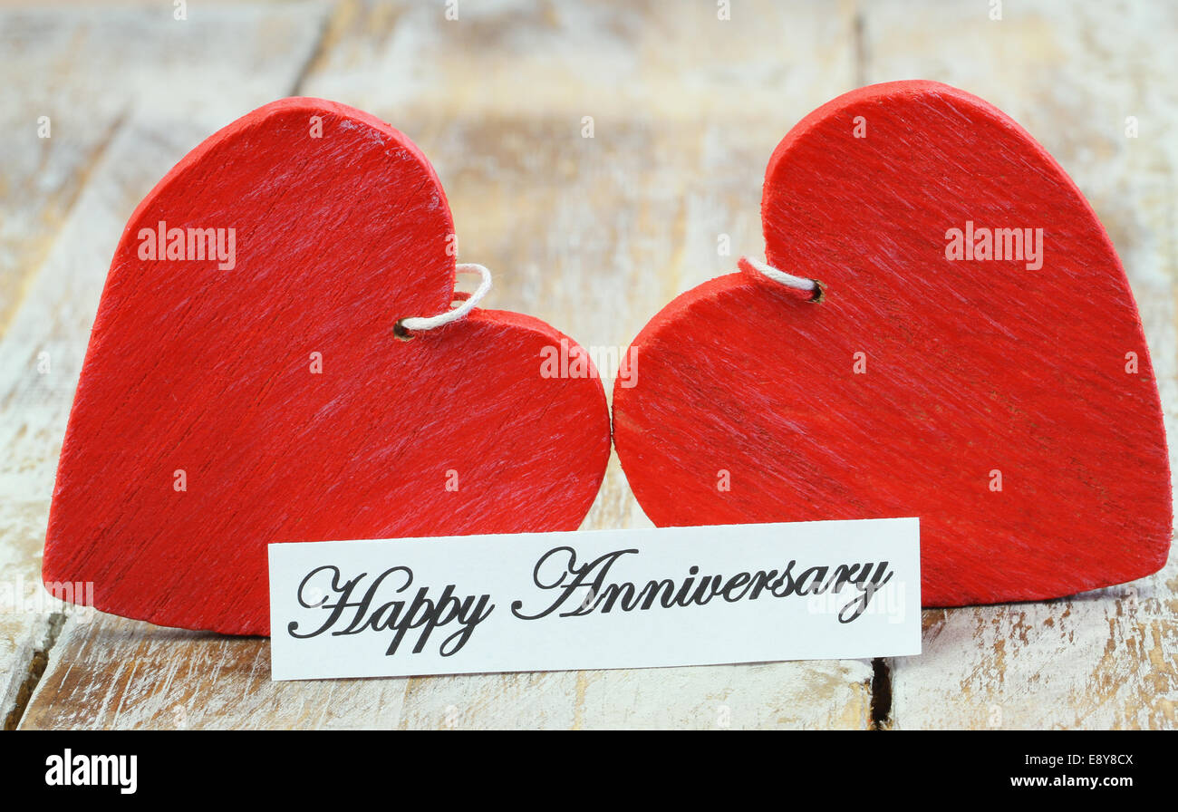 Anniversario Matrimonio In Inglese.Happy Anniversary Card With Two Red Wooden Hearts Stock Photo