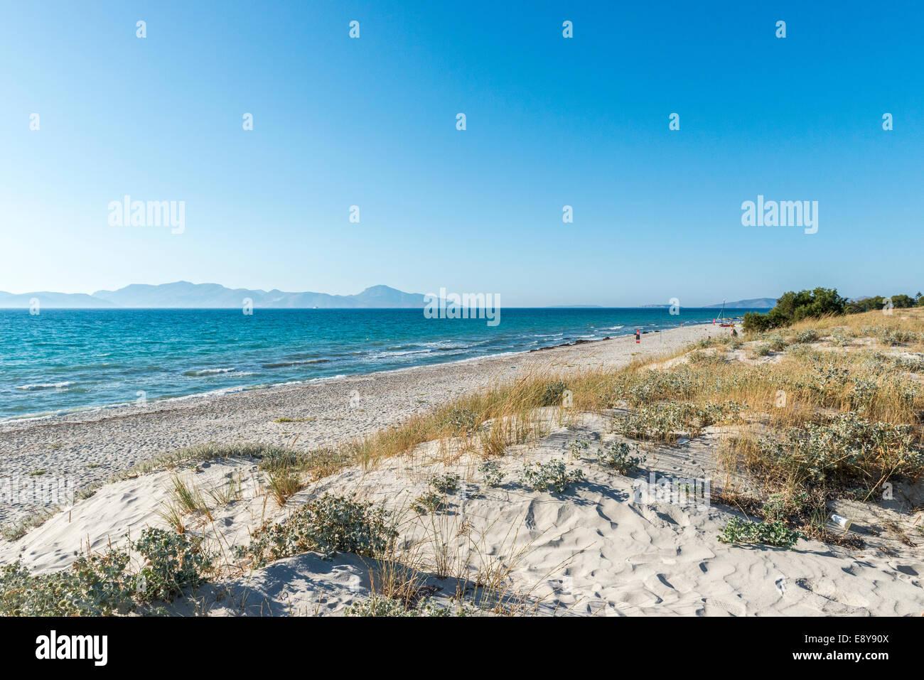 Empty beach, sand dunes and Mediterranean Sea, panoramic view, Mastichari, Kos, Greece - Stock Image