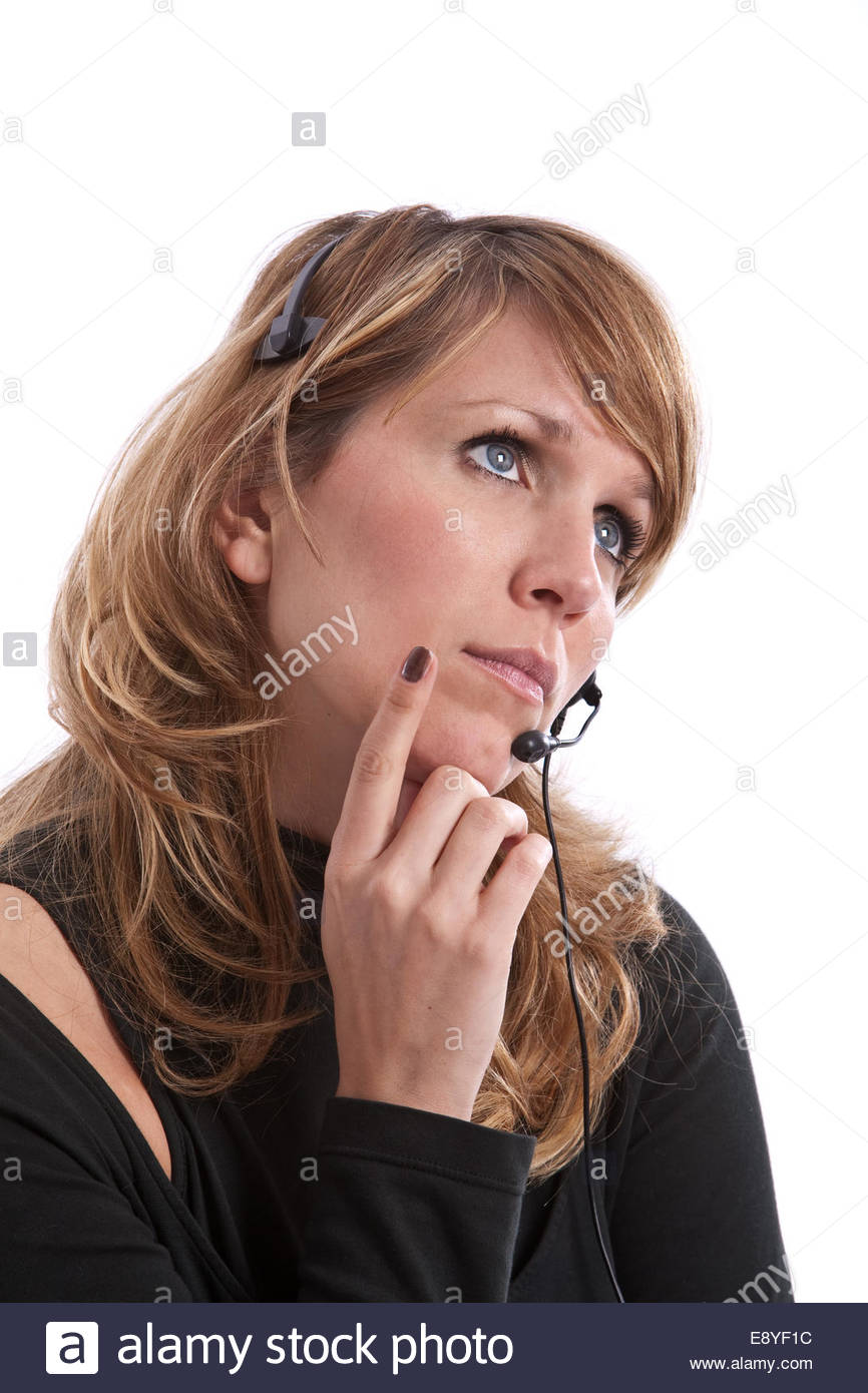 Thoughtfull telephone operator - Stock Image