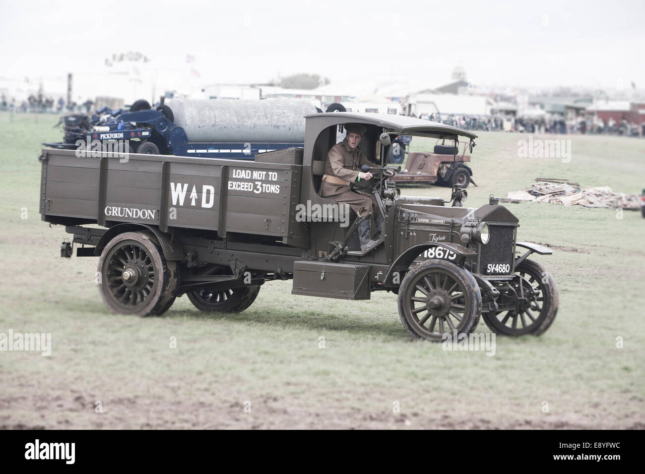 A WW1 1916 Thornycroft War Department (WD) lorry being driven by a British Army soldier in period uniform. - Stock Image