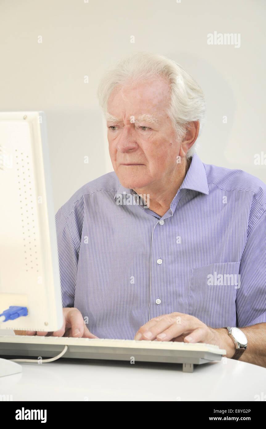 Senior at the computer - Stock Image