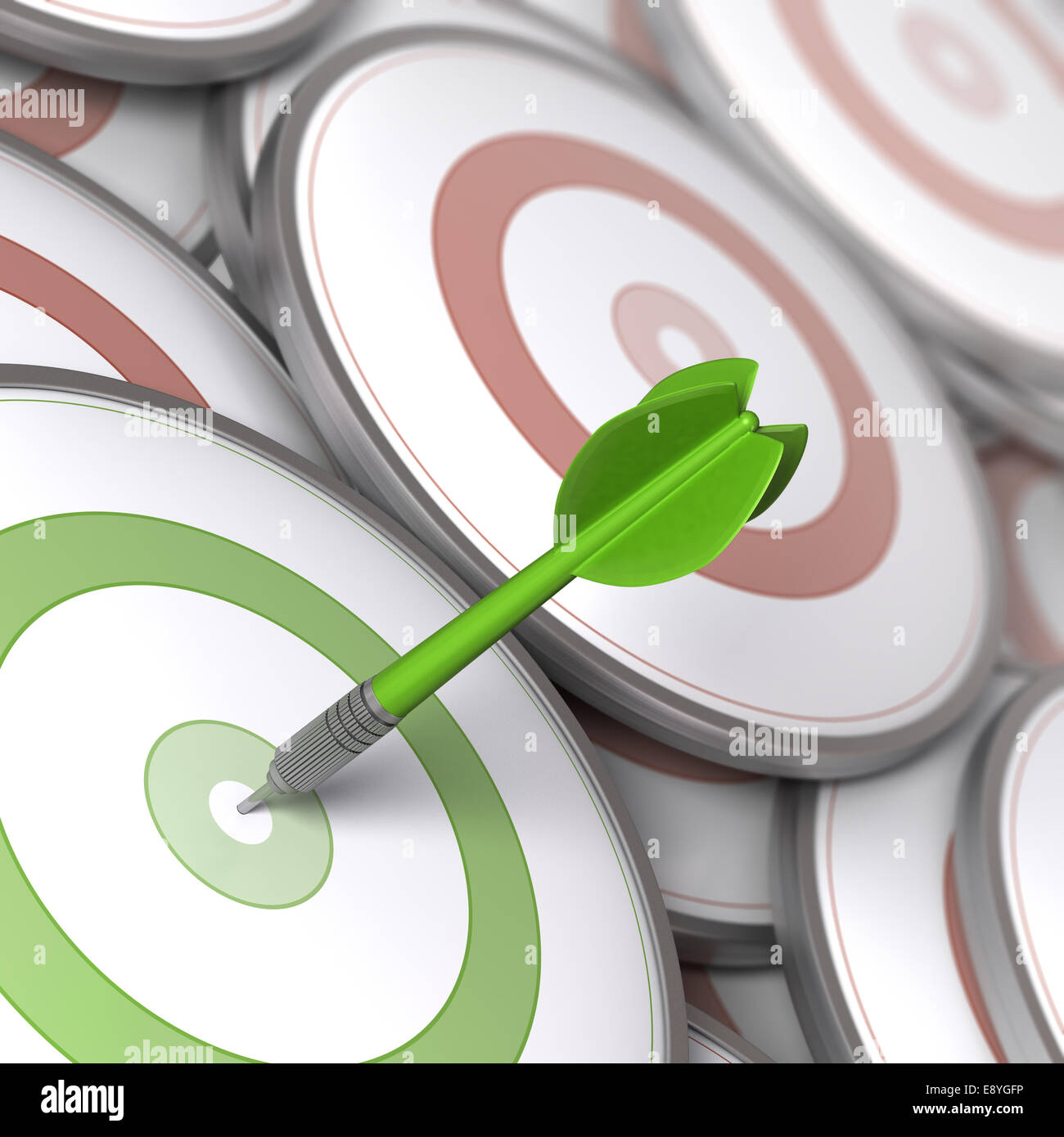 One dart hitting the center of a modern dartboard, targets concept to illustrate Business options or Marketing strategies. - Stock Image