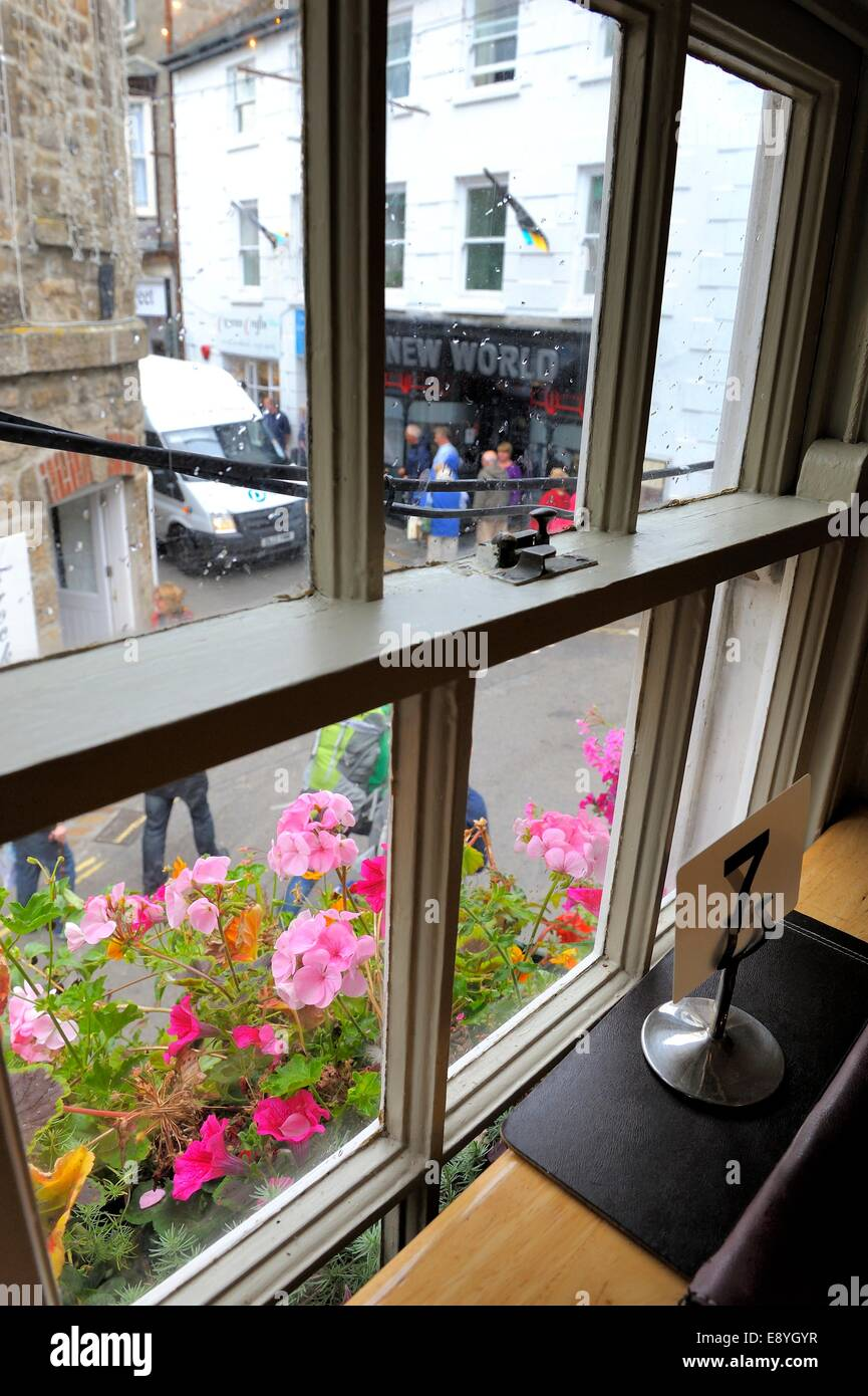 A view from table number 7 in an upstairs cafe St Ives Cornwall England uk - Stock Image