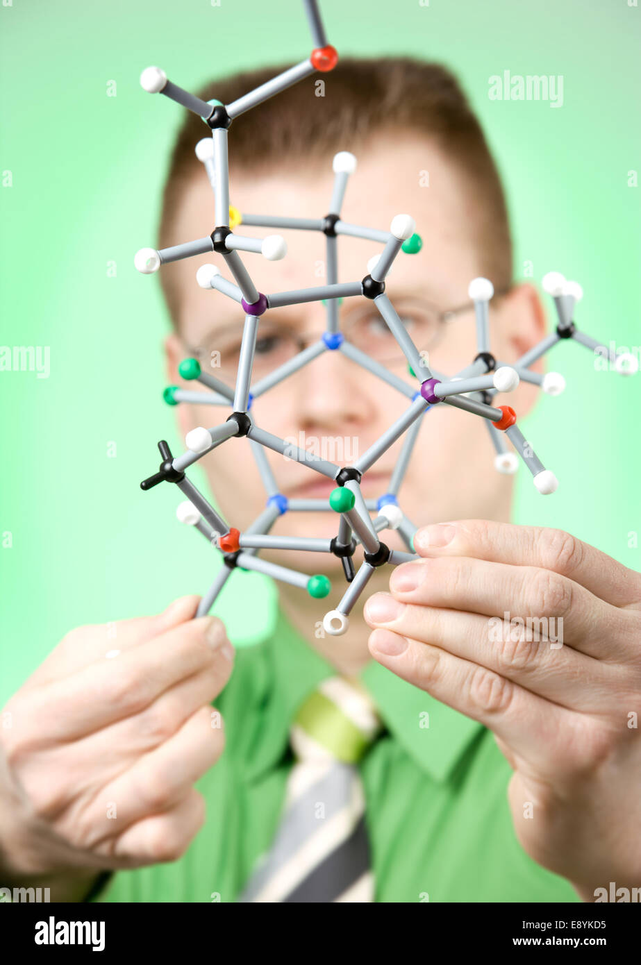close up portrait of young chemist - Stock Image