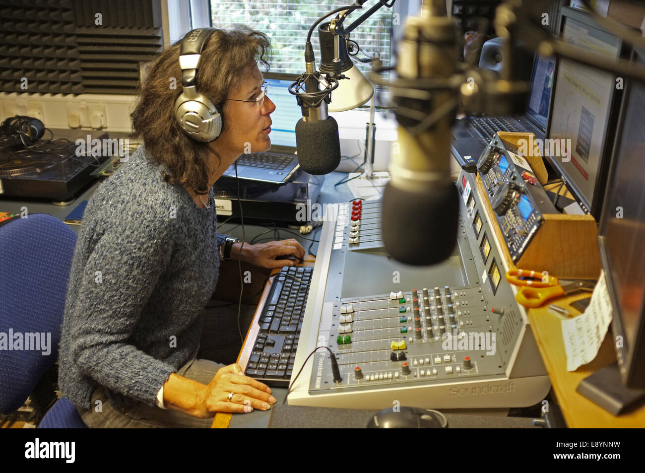A local radio DJ, Val Baker on The Source 96.1 FM a volunteer run community radio station in Falmouth, Cornwall, - Stock Image