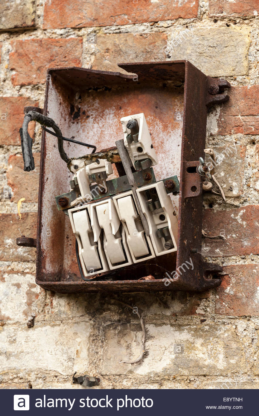 Old fashioned and broken fuse box - Stock Image