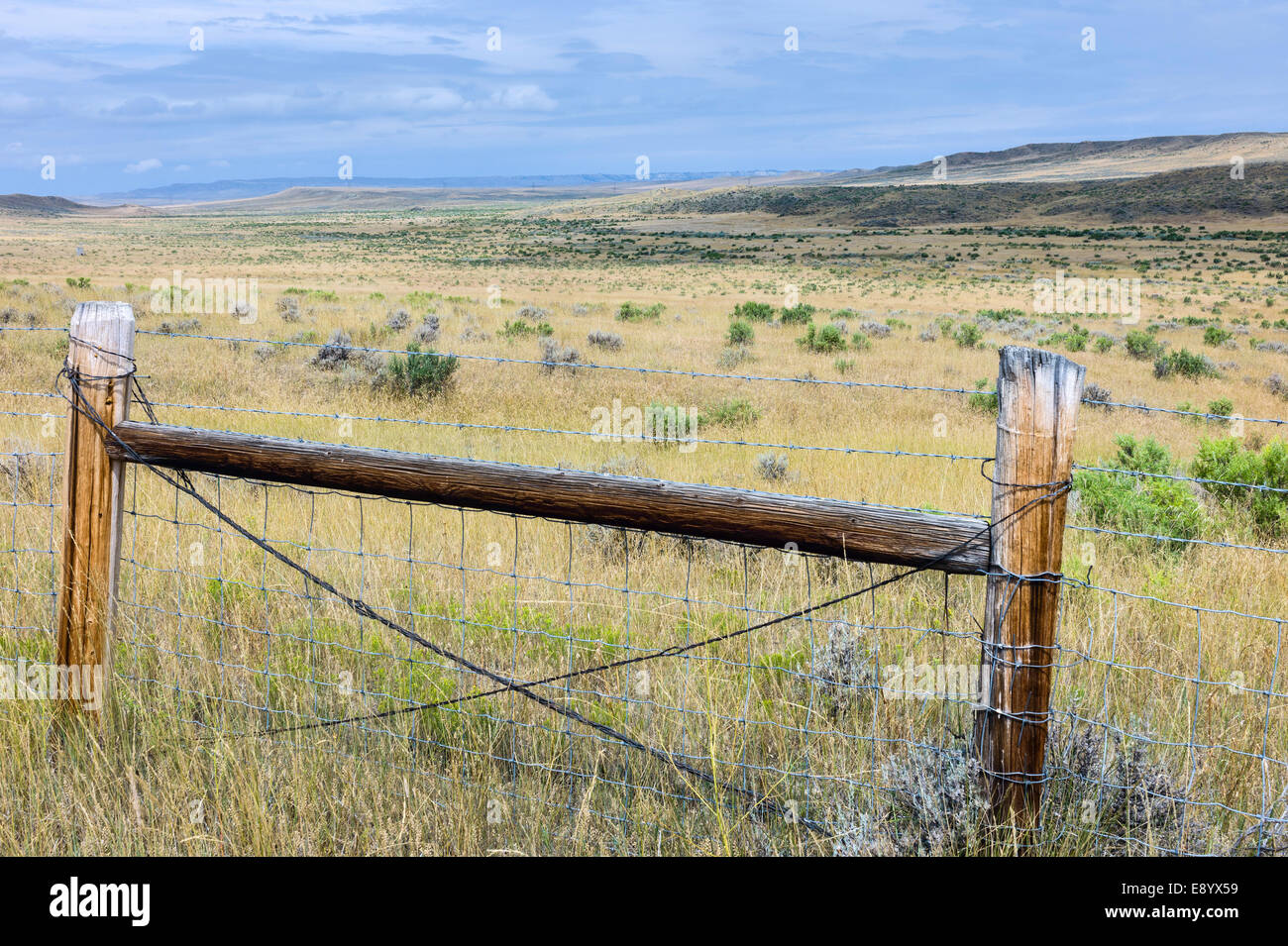 Open prairie, grassland, and dry scrub and hills under a bright sky near Vermillion, Nebraska, USA. Stock Photo