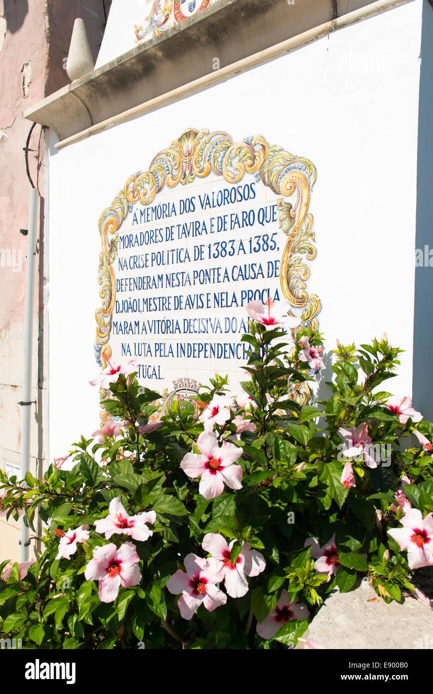 Portugal Algarve Tavira memorial plaque for political martyrs 1383 to 85 defending the Roman Bridge flowers Stock Photo