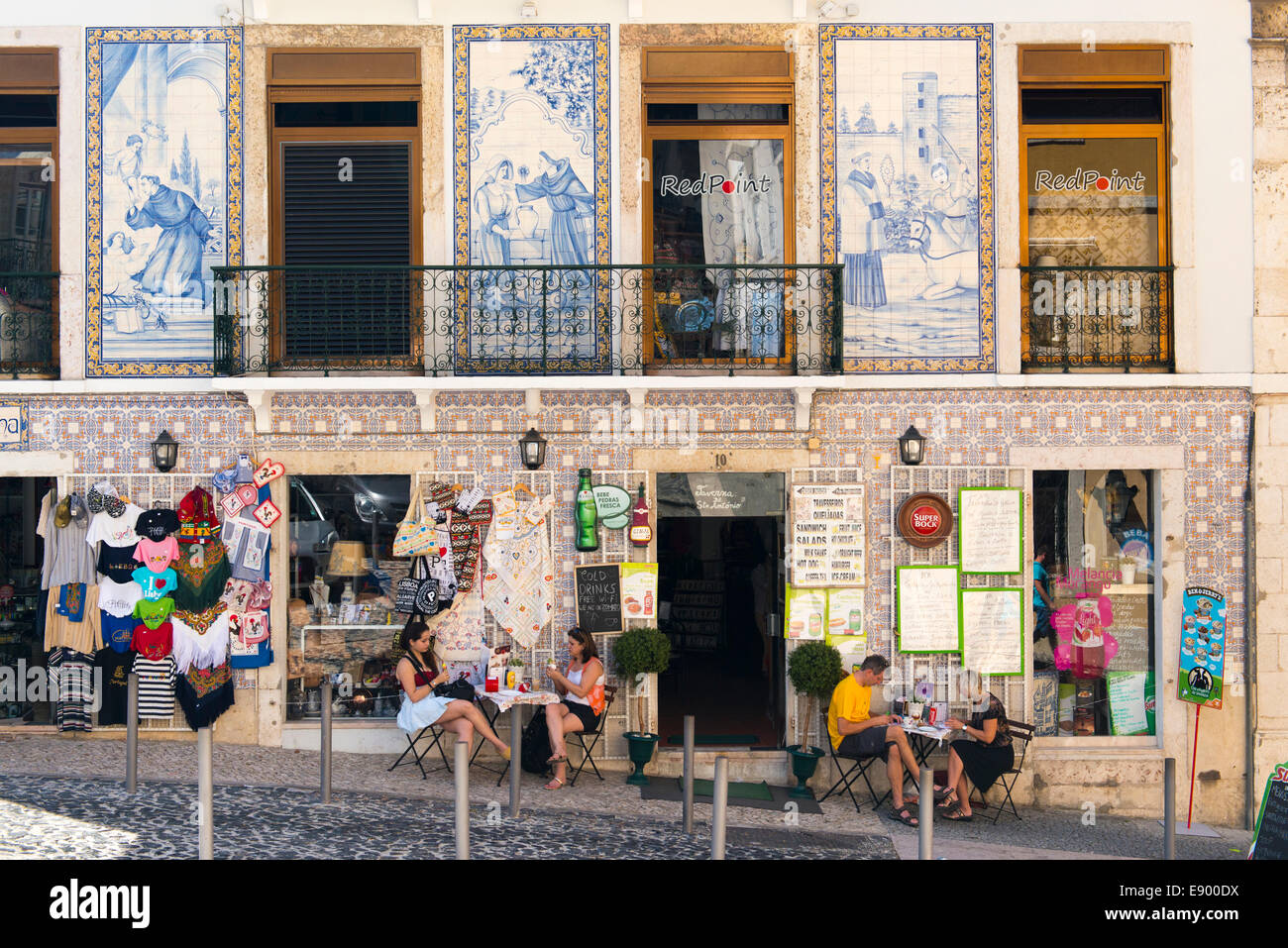 Portugal Lisbon Alfama Taverna do St Antonio hillside pub pavement sidewalk cafe snack bar bistro souvenir shop Stock Photo