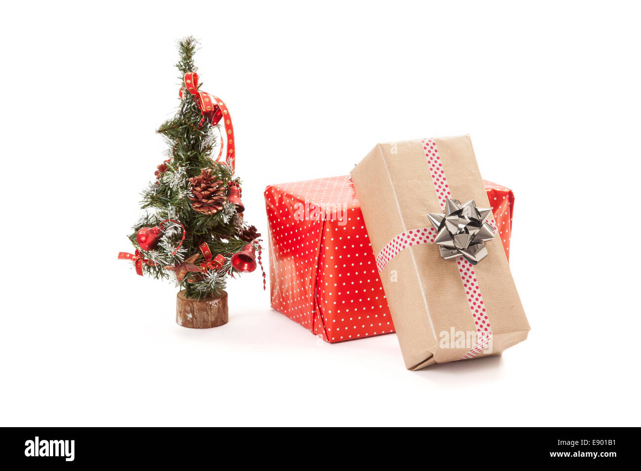 Christmas gifts and a small decorative christmas tree Stock Photo ...