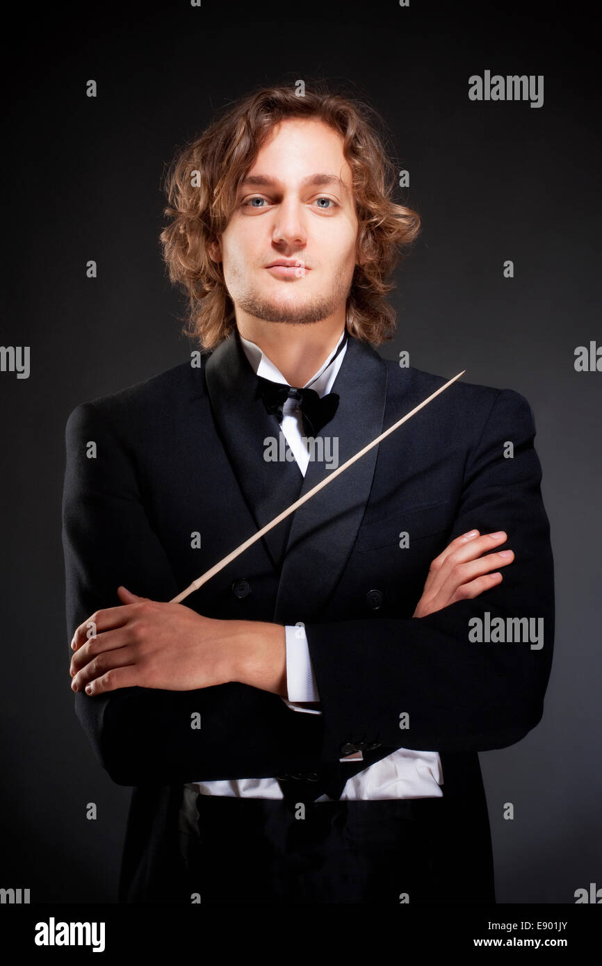 Portrait of a Young Conductor Holding a  Baton. - Stock Image