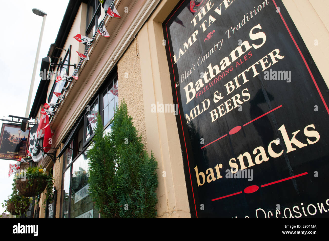 Front of the Lamp Tavern pub in Dudley one of the Bathams Brewery traditional pubs with the Black Country flag flying - Stock Image