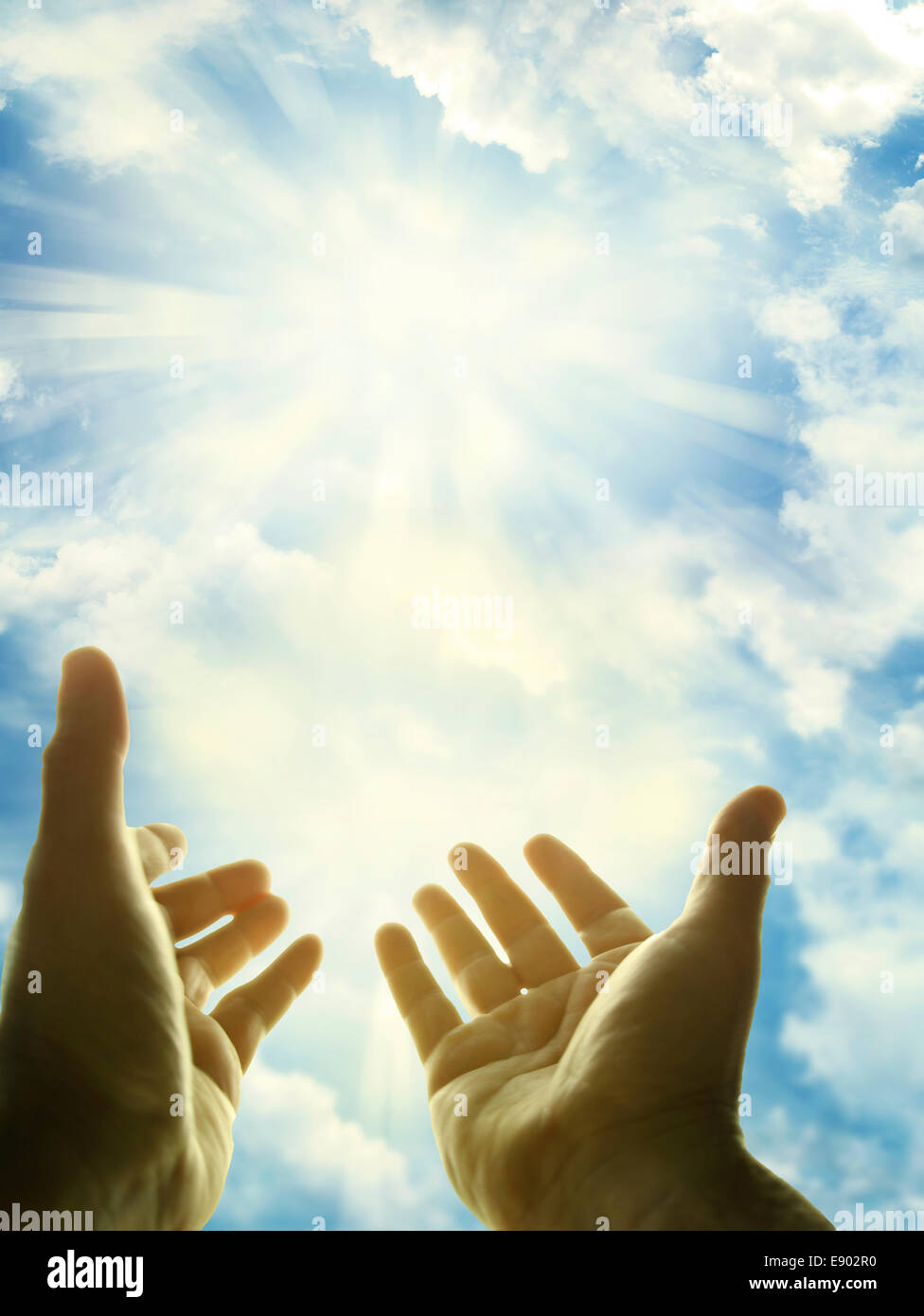 Hands reaching for the sky - Stock Image