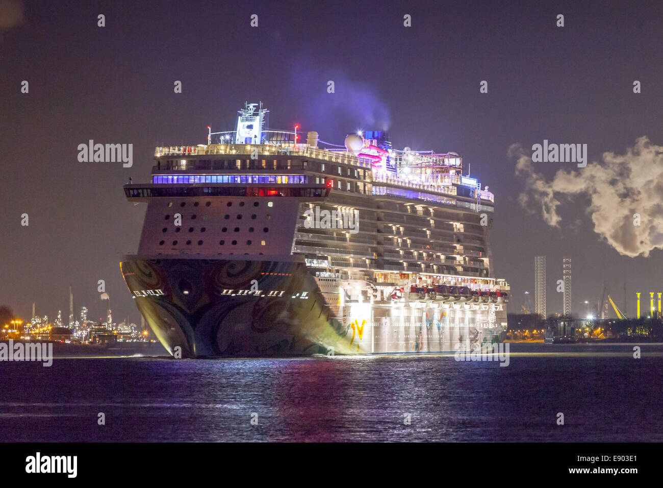 Nightly departure of Norwegian Getaway cruise ship of the Norwegian Cruise Line (NCL) from Rotterdam Port Holland - Stock Image