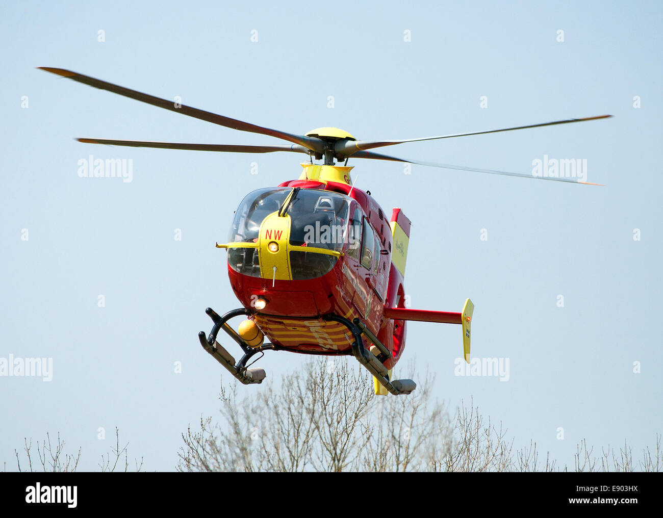 The Cornwall Air Ambulance in flight - Stock Image