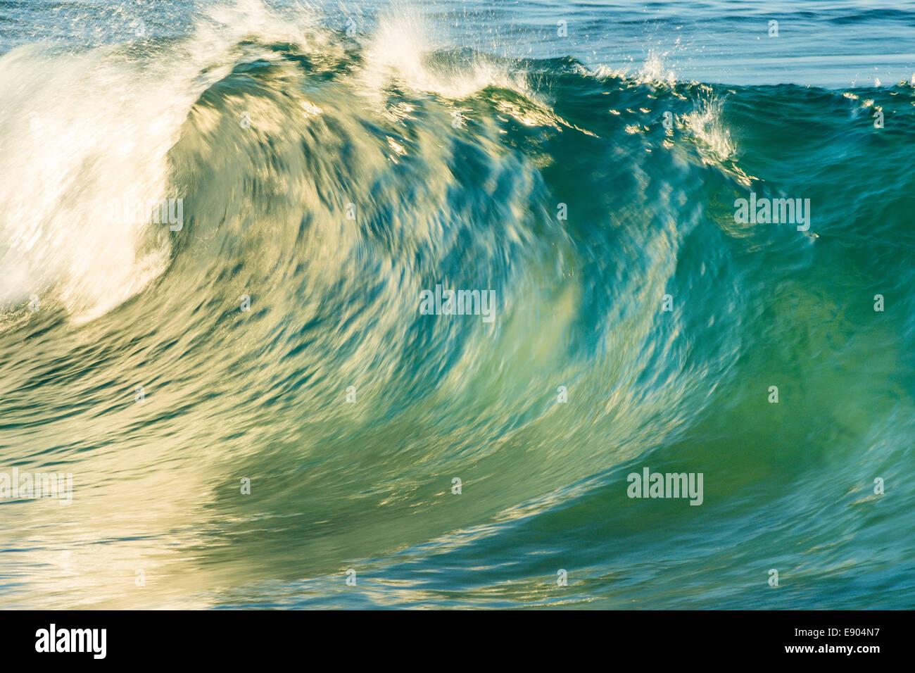 Breaking wave, Adder Rock, North Stradbroke Island, Queensland, Australia - Stock Image