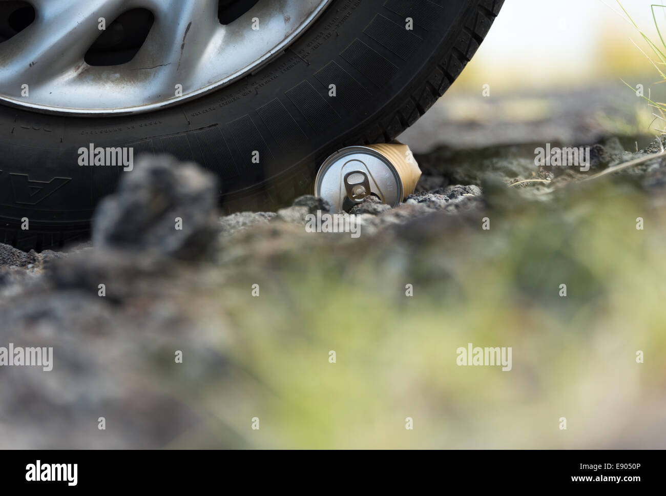 Car drove on trash can - Stock Image