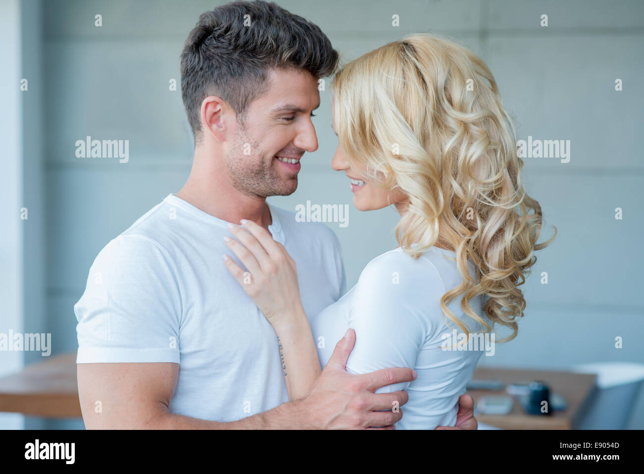 Loving couple looking into each others eyes - Stock Image