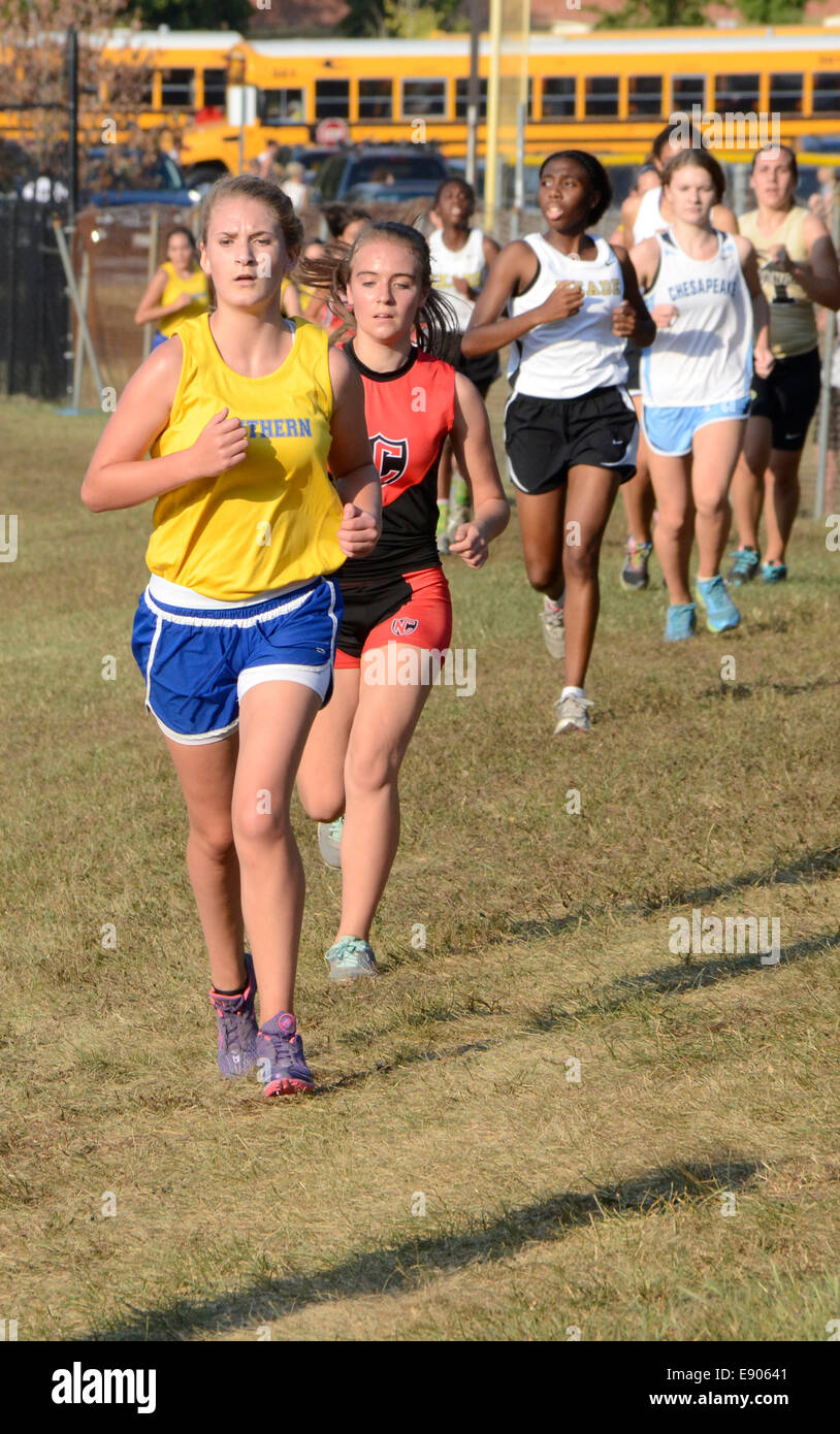 Girls running in a cross country race - Stock Image