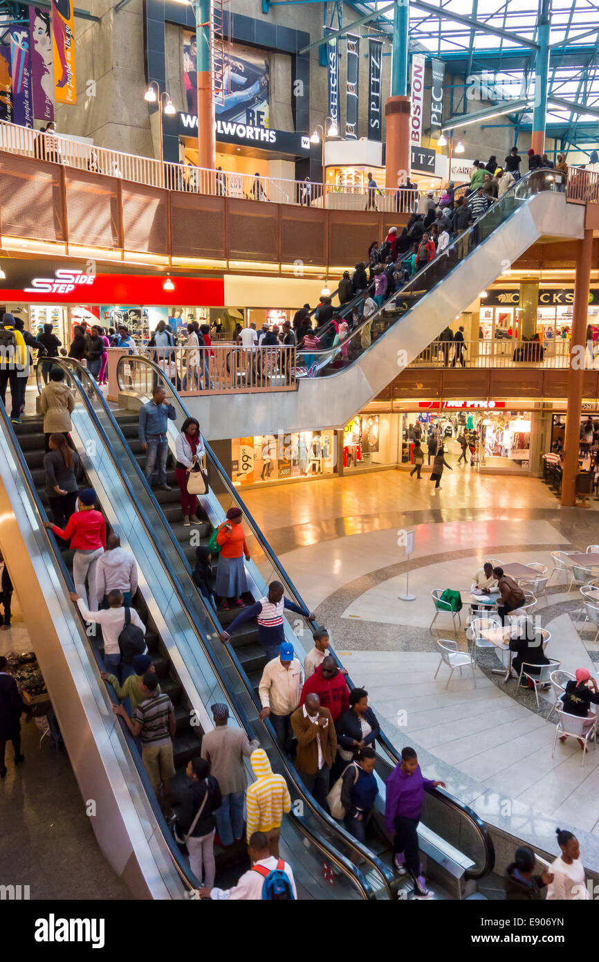 JOHANNESBURG, SOUTH AFRICA - People on escalator in shopping center, in Carlton Centre. - Stock Image