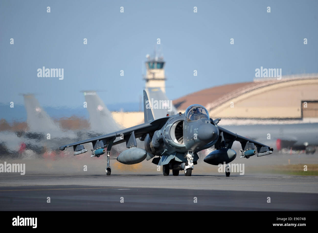 A U.S. Marine Corps AV-8B Harrier II aircraft assigned to Marine Attack Squadron (VMA) 311 taxis on the flight line Stock Photo