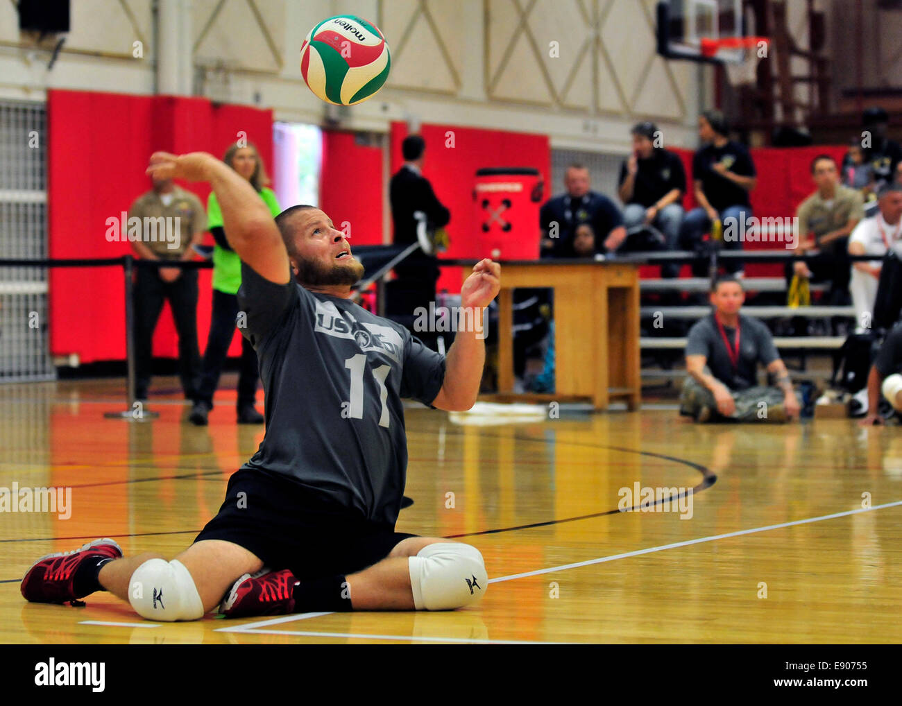 Retired U.S. Army Spc. Kyle Butcher serves during a sitting volleyball game between the U.S. Special Operations Stock Photo