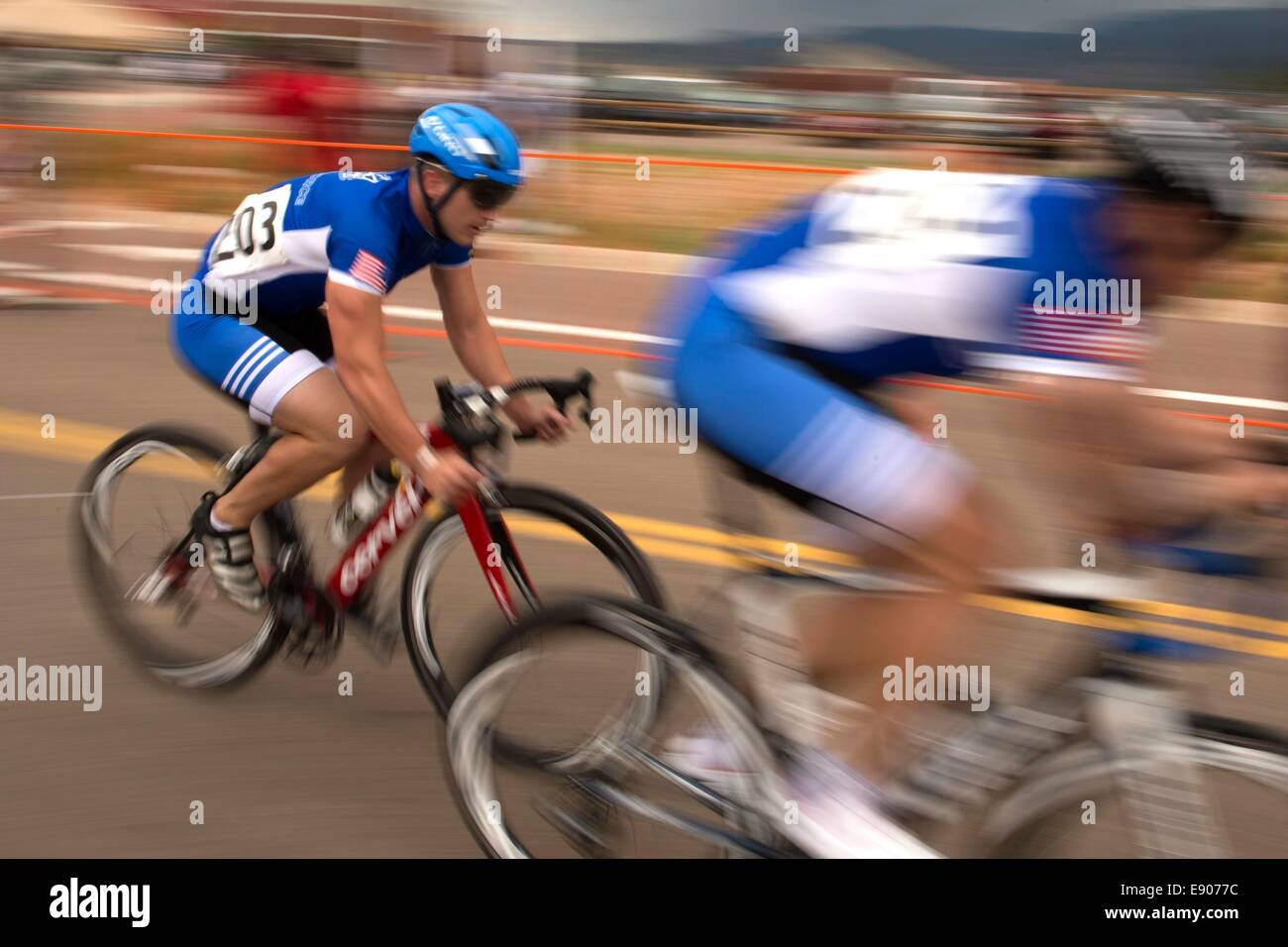 U.S. Air Force Capt. Mitchell Kieffer and Senior Master Sgt. Jason Hoover compete in the men's open cycling event Stock Photo