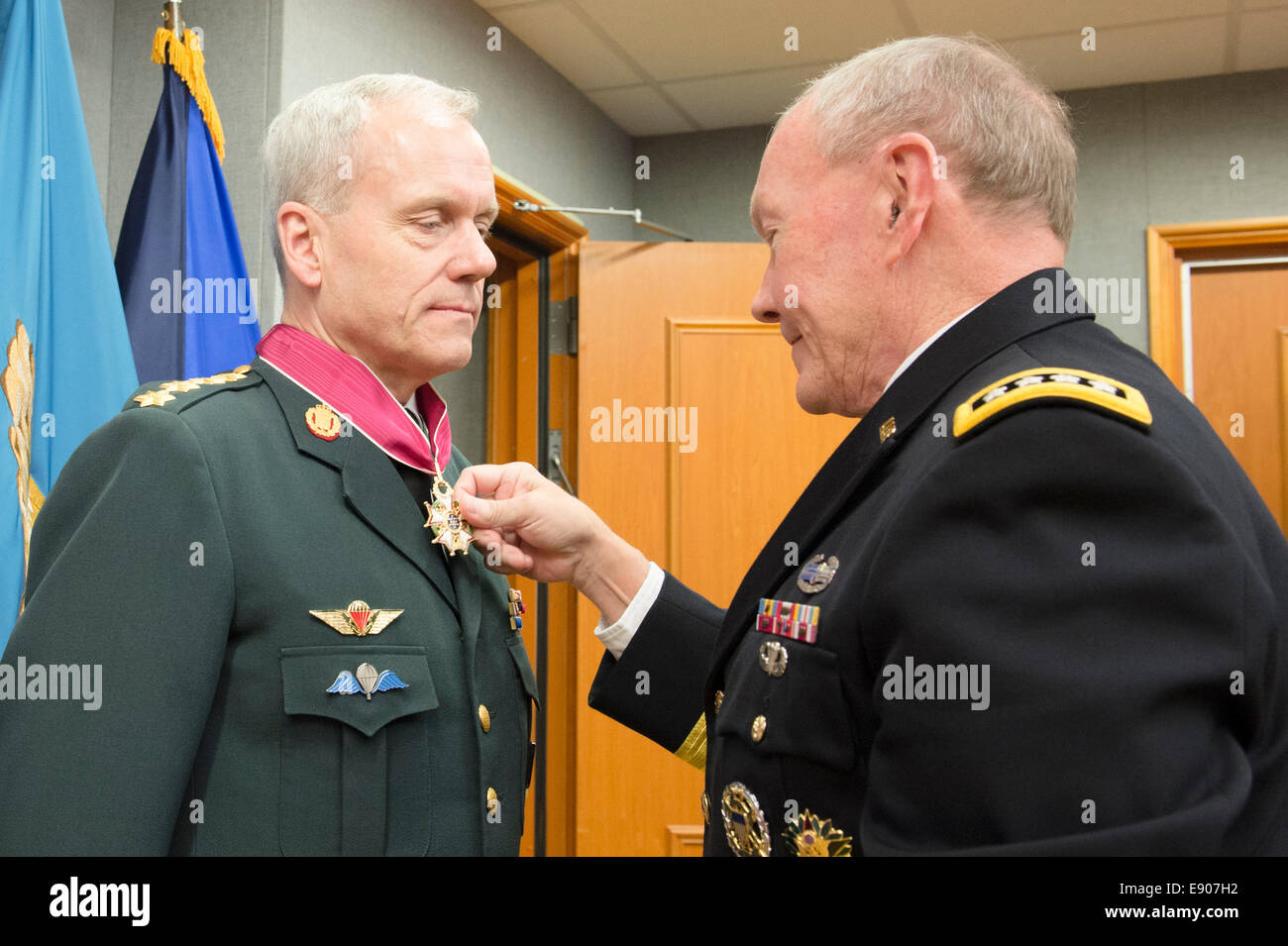 Chairman of the Joint Chiefs of Staff U.S. Army Gen. Martin E. Dempsey, right, presents a Legion of Merit medal Stock Photo