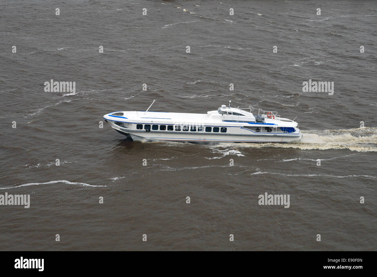 The passenger boat moves on the river - Stock Image