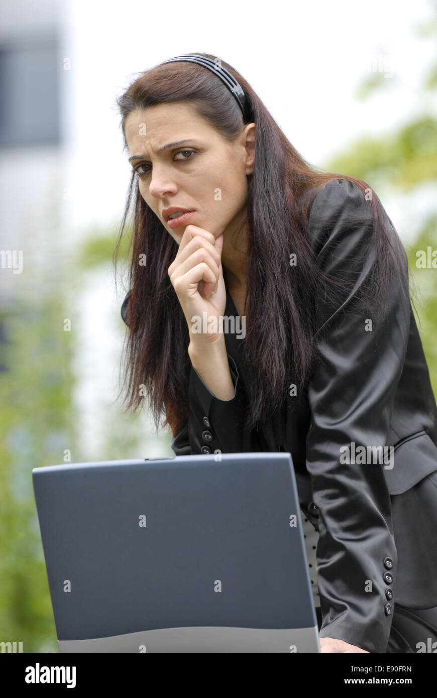 thoughtfull young woman - Stock Image