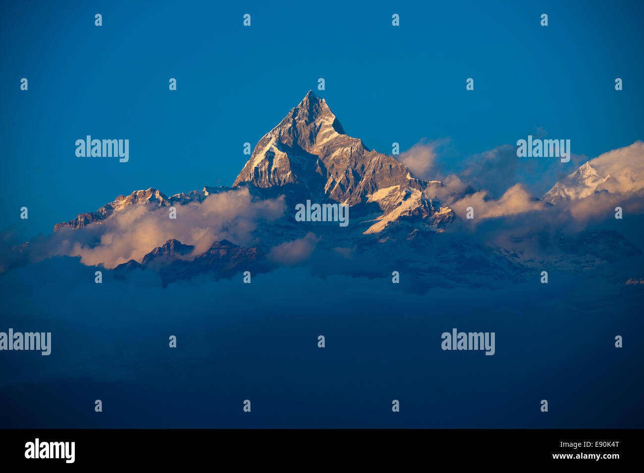 Machapuchre Himalayan Peak Clouds - Stock Image