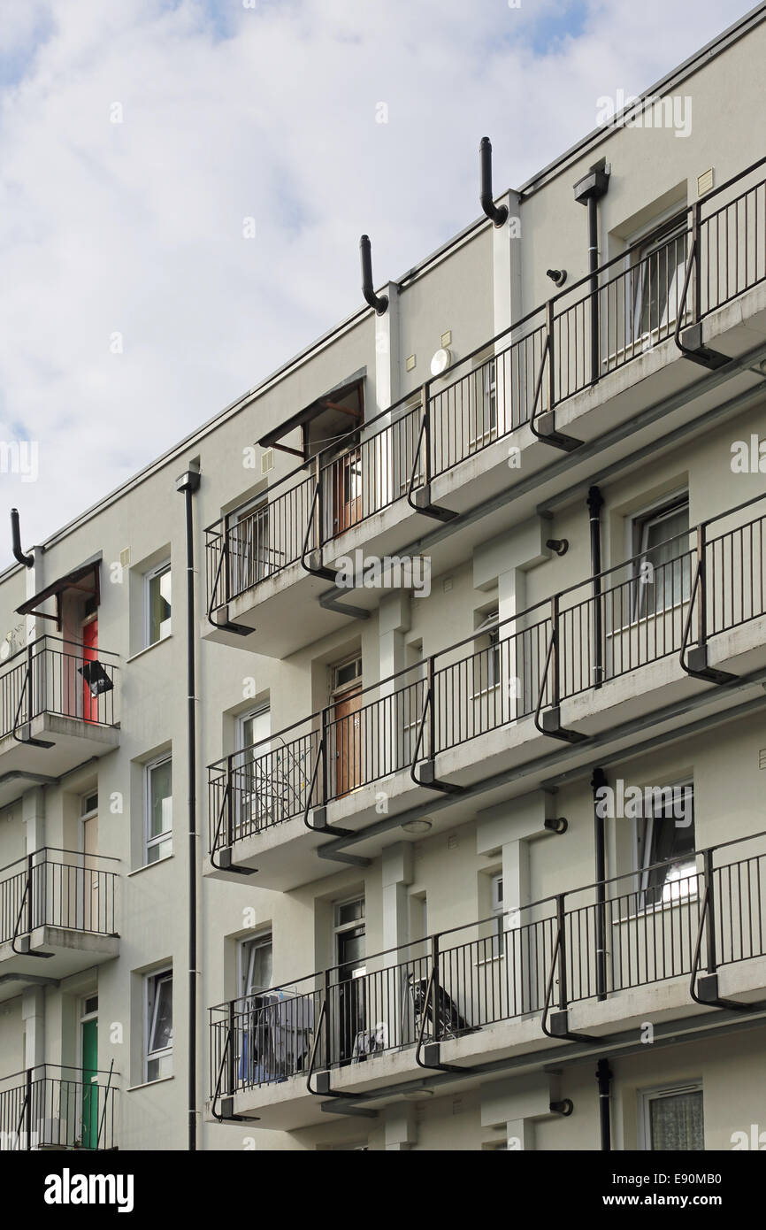 Access balconies on a newly refurbished block on a south London council estate - Stock Image