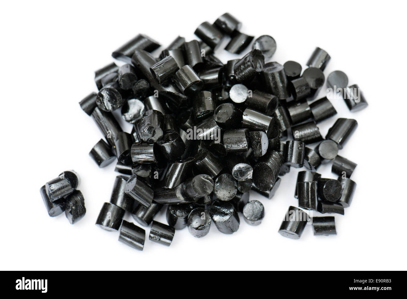 black pieces liquorice candy, on white background - Stock Image