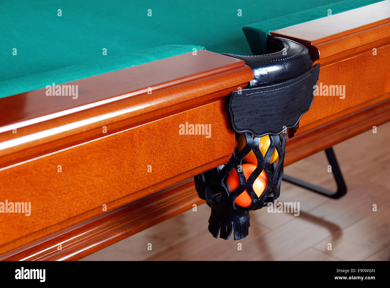 Balls in Billiards table pocket - Stock Image
