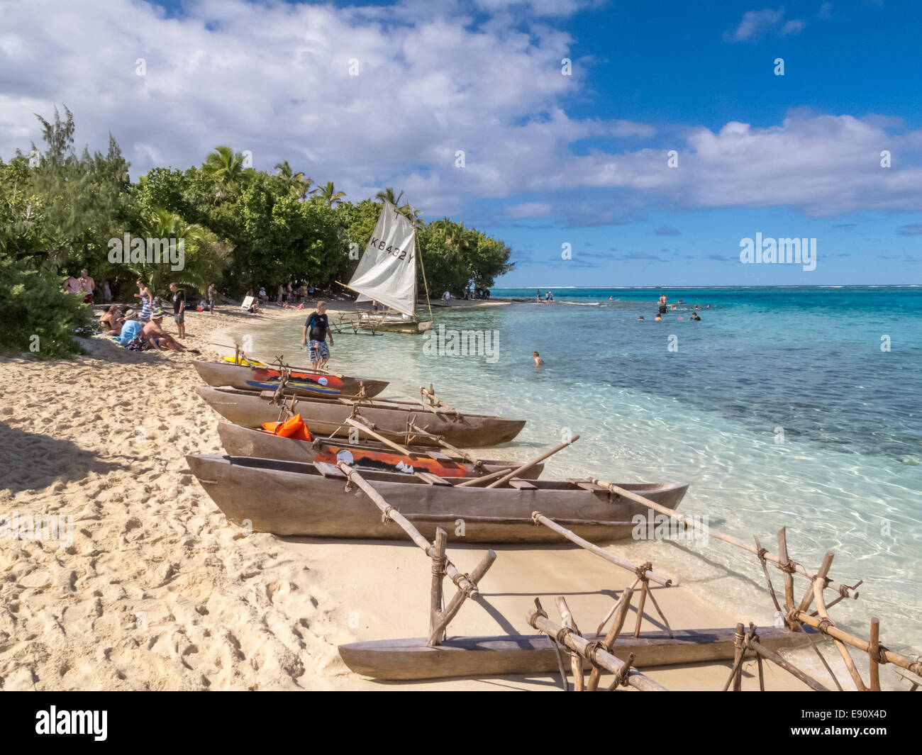 Traditional dugout outrigger canoes at Mystery Island, Vanuatu. - Stock Image